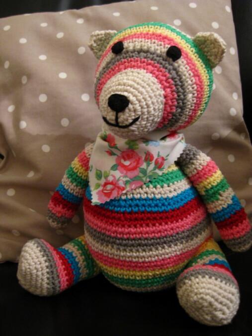 Multicoloured crochet teddy bear
