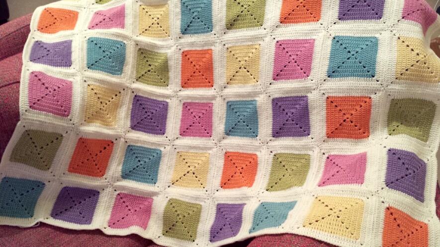 Rainbow granny square blanket
