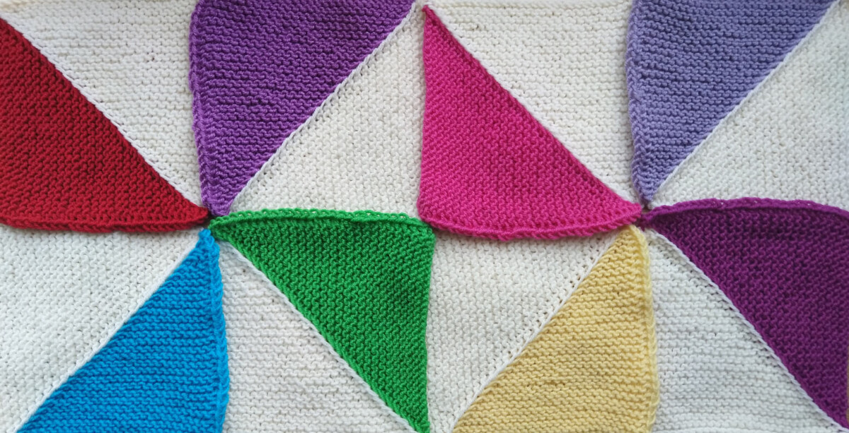 Multicoloured knitted triangle squares